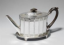 A George III London silver teapot and stand. Marks of William Vincent, 1809.