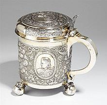 A baroque Moscow partially gilt silver tankard and cover. With a small crack to the edge of the lid. Marks of Master WMO, 1747.
