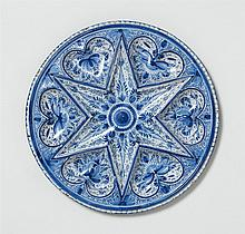 A blue and white Nuremberg faience star platter