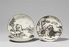 Three encre de Chine saucer dishes. Qianlong period (1735-1796)