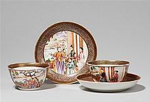 A pair of famille rose cups with saucers. Qianlong period (1735-1796)
