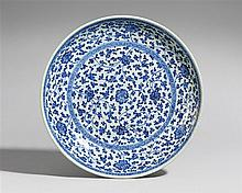 A Ming-style blue and white saucer-dish. Qianlong period (1735-1796)