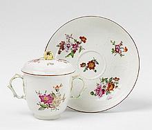 A large KPM porcelain beaker.