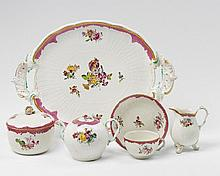 A KPM porcelain tea service with floral decor. W