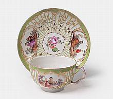 A KPM porcelain teacup with scenes after Watteau.