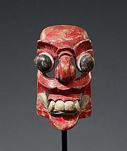 A Sri Lanka polychrome wood mask of a demon. Around 1900