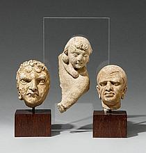 Three small Hadda stucco heads. 3rd/4th century