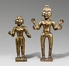 A pair of brass figures. 20th century