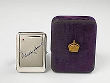 A Berlin partially gilt and enamelled silver Royal Prussian presentation box. Inscribed in blue enamel with crown prince William's signature to the lid, the corners incrusted with rubies, the push-button set with a sapphire. In the original blue