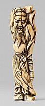 A very unusual and large ivory netsuke of Kan'u. 18th century