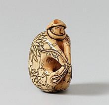 A highly unusual ivory netsuke of a saru ningyo. 18th century.