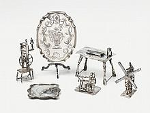 Six silver miniatures. Comprising a table,