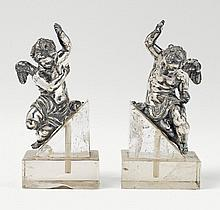A pair of silver putti. Unmarked, probably South