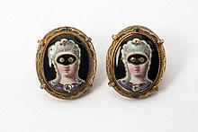 A pair of cufflinks with enamel miniatures. 2.3 x