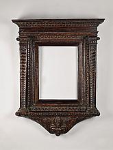 An Italian renaissance carved walnut tabernacle frame.
