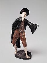 An ivory and wood figure of Pantalone