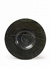 A Saxon serpentine dish with a wide brim