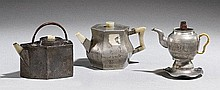 A group of three paktong teapots. Around 1900