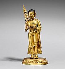 A Tibetan gilt bronze figure of Maudgalyayana. 17th/18th century
