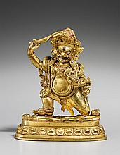 A Tibetan gilt bronze figure of Acala. Possibly 19th century