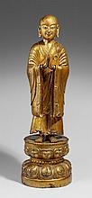 A Mongolian gilt and laquered wood figure of luohan Ananda. 19th century