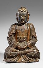 A heavily cast iron figure of a Buddha. Ming dynasty