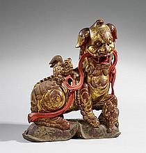 A large gilded and lacquered wood figure of a Buddhist lion-dog. 18th/19th century