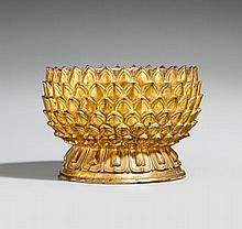 A gilded bronze lotus base. 16th/17th century