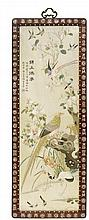 A framed embroidered silk panel. Around 1900