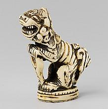 A stag antler seal-type netsuke of a fabulous beast. 19th century