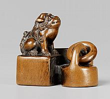 A boxwood netsuke of a group of seals. 19th century