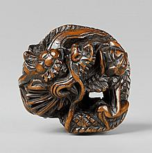 A boxwood netsuke of a large dragon. Early 19th century