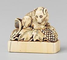 An ivory seal-type netsuke of a squirrel on a vine. Early 19th century