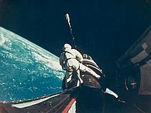 NASA, Astronaut Richard Gordon attaches a tether line from the spacecraft to the Agena target docking vehicle, Gemini XI, 1966