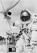 NASA, Astronaut David R. Scott adjusts the highgain antenna on the lunar roving vehicle, 1971