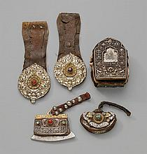 A group of a Tibetan g´au box, one flint-pouch, one money-pouch and one pair of belt ornaments