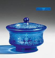 A transparent blue glass footed bowl with matching lid. Yongzheng mark and possibly of the period