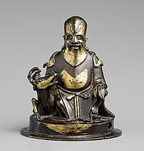 A partly gilt bronze figure of Shoulao. Probably 17th century