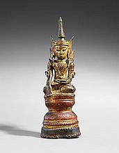 A Burmese lacquered and gilded bronze figure of a jewelled Buddha. 18th/19th century