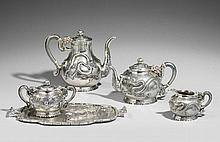 An elaborate six piece tea and coffee set. Around 1900