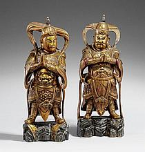 Two lacquered and gilded wood figures of guardian gods. 19th century