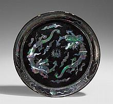 A black lacquer dish with mother-of-pearl inlays. Ryûkyû. 17th/18th century