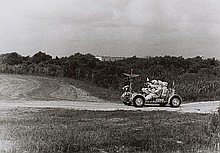 NASA, Apollo 15 backup astronauts Gordon Jr. and Schmitt drive a training model of   the lunar roving vehicle, Kennedy Space Center,  1971