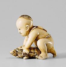 An Edo/Tokyo school ivory netsuke of a boy with a tortoise, by Hôjitsu. Second half 19th century