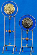 PAIR OF GLASS PENDANTS ON BRASS STANDS