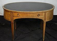 VINTAGE BAKER OVAL LEATHER TOP WRITING TABLE