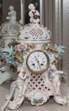 Capodimonte style porcelain clock featuring cherubs and floral accents (imperfections)