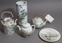 Five pieces: three Chinese teapots, underplate and brush pot