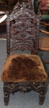Late 19th century Flemish design hall chair with carved lion decoration