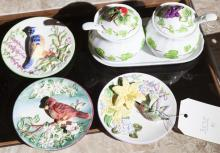 Four decorative porcelain wall plaques featuring birds along with a relish set with an underplate